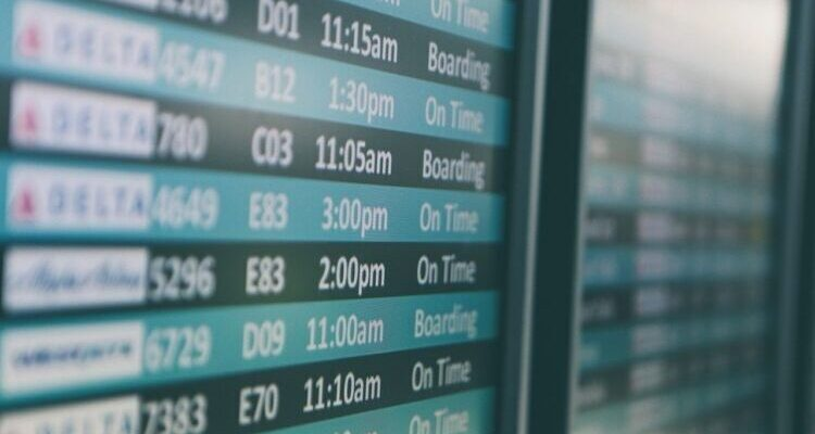 Airport Departure Board with only the time of departure in focus