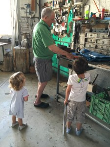 My dad, making toys for a very attentive audience.