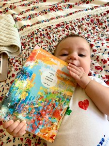 Baby chewing on colorful book