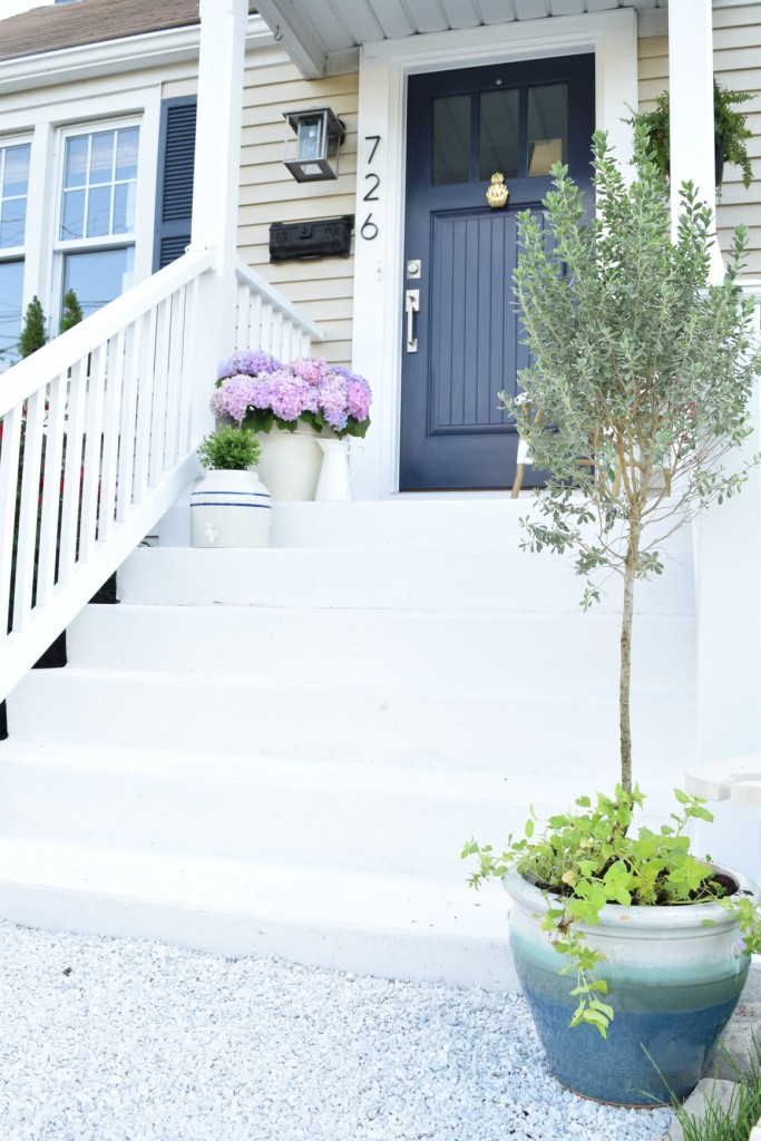 exterior update and curb appeal with pebble rocks