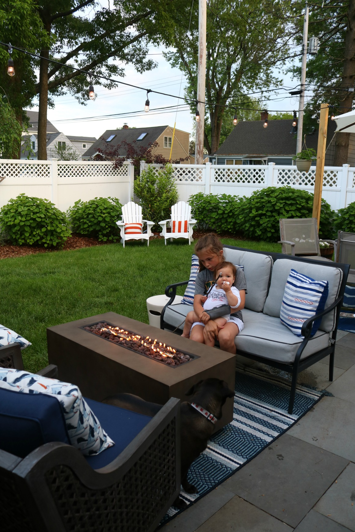 Cozy Small Backyard with Fire pit