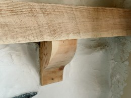 Our Limewashed White Rock Fireplace with Bleached Wood Mantle