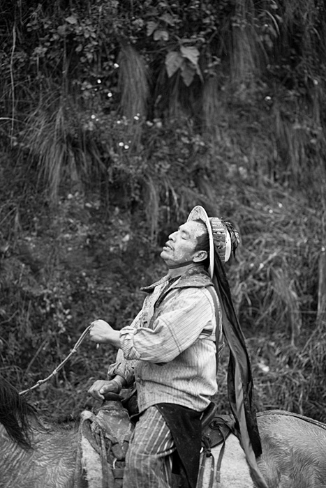 Man taking a breath after racing with the horse. Day of the Death at Todos Santos, Guatemala