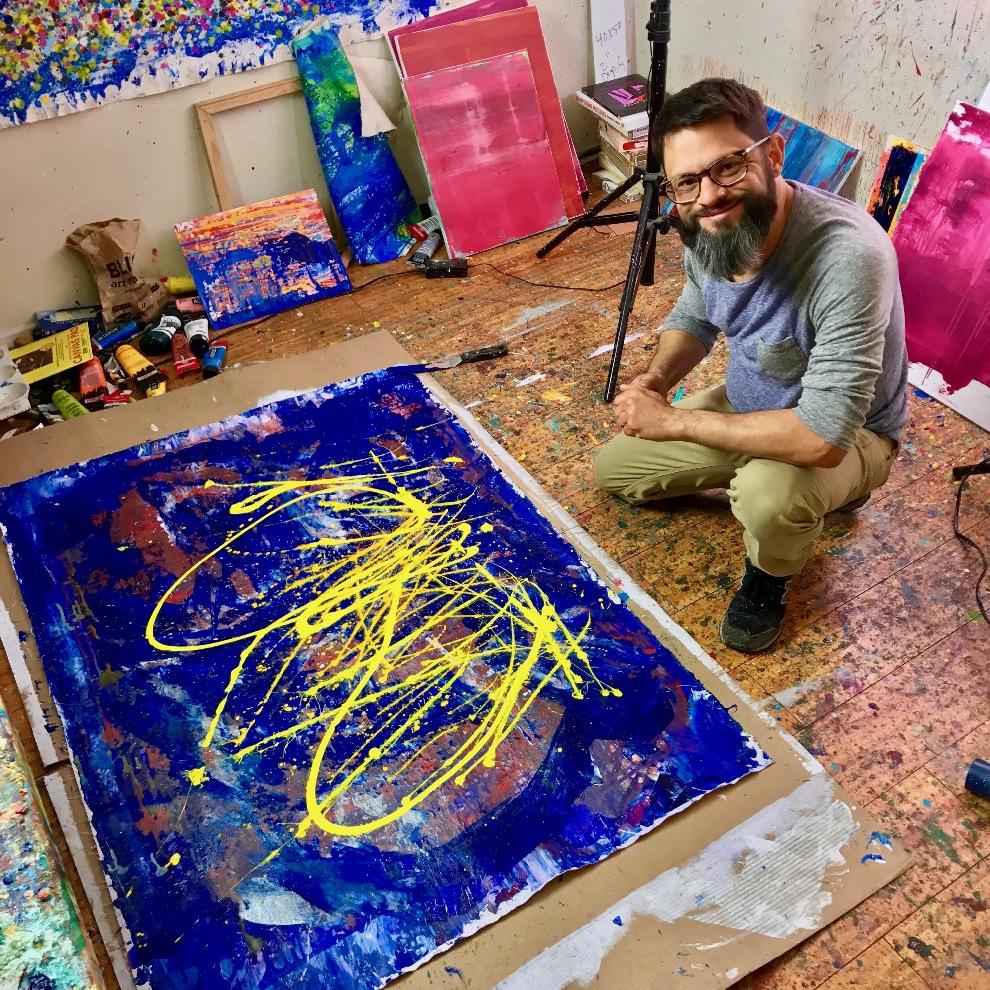 Artist Nestor Toro working in his studio
