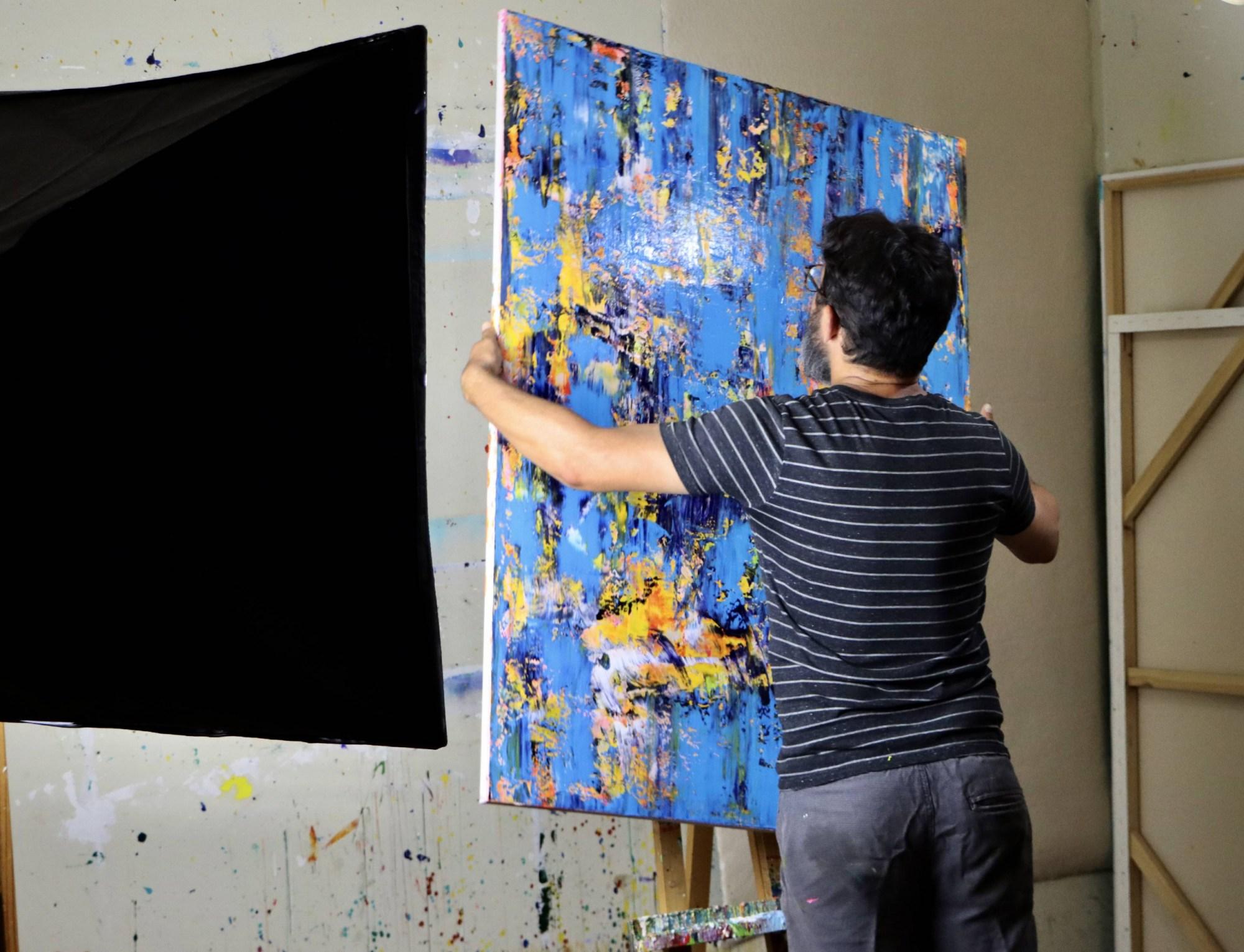 Nestor Toro in the studio creating this very work - Rapid Iridescent Cascades (2020) by Nestor Toro