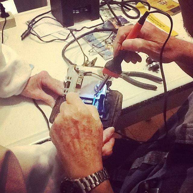 My dad soldering the Lionel controller his dad gave himhellip