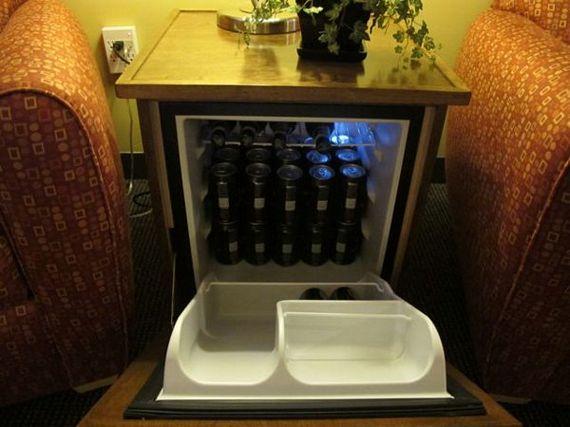 man table hides a mini fridge behind