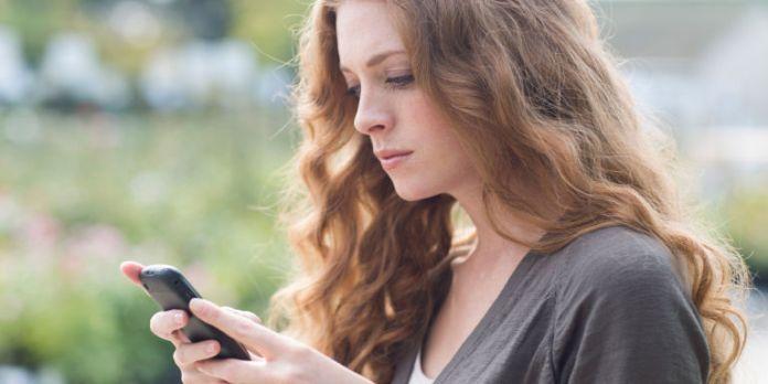 Sad woman on mobile phone