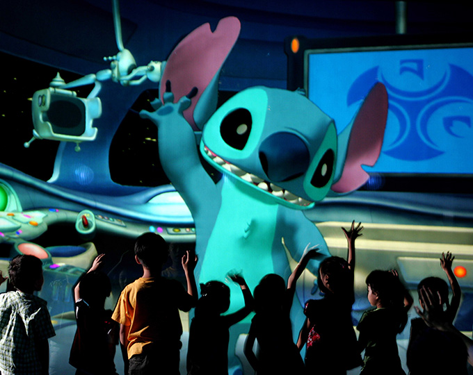 0620AU_0369JD.jpg 0620AU_0383JD.jpg SAY HELLO TO ヤSTITCHユ: In this photo taken inside メStitch Encounter,モ the tiny and talkative alien known as メStitchモ waves to guests as they enter Space Control Traffic Center at Hong Kong Disneyland.  The mischievous blue alien, who debuted in Disneyユs hit animated comedy メLilo & Stitch,モ stars in the new cutting-edge attraction where park guests, seated in an intimate theatre, carry on real-time conversations with the famous animated character.  The jaw-dropping technology allows for Disney fun like never before.  Stitch, aka メExperiment 626,モ can talk to guests, play games and interact with them in surprising new ways.  When it officially opens to guests July 13, 2006, Stitch Encounter will be presented daily in three languages ミ Cantonese, English and Putonghua.  Hong Kong Disneyland is the first and only Disney theme park in the world where guests can experience Stitch Encounter. (Jimmy DeFlippo, photographer)