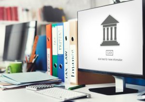 Computer screen and law books
