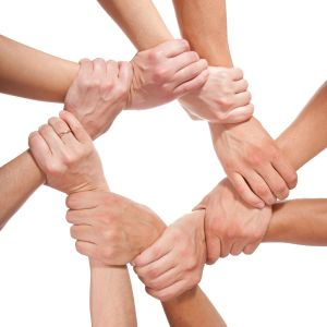 Hands forming a circle linked at wrists