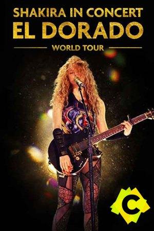 Shakira - El Dorado World Tour. Shakira rubia tapándose la cara con el pelo y tocando la guitarra de pie
