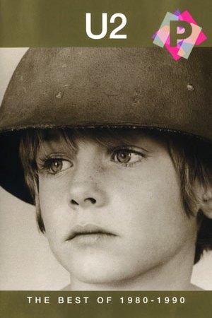 U2 - The Best Of 1980-1990 -Cara de un niño triste con un casco militar sobre su cabeza