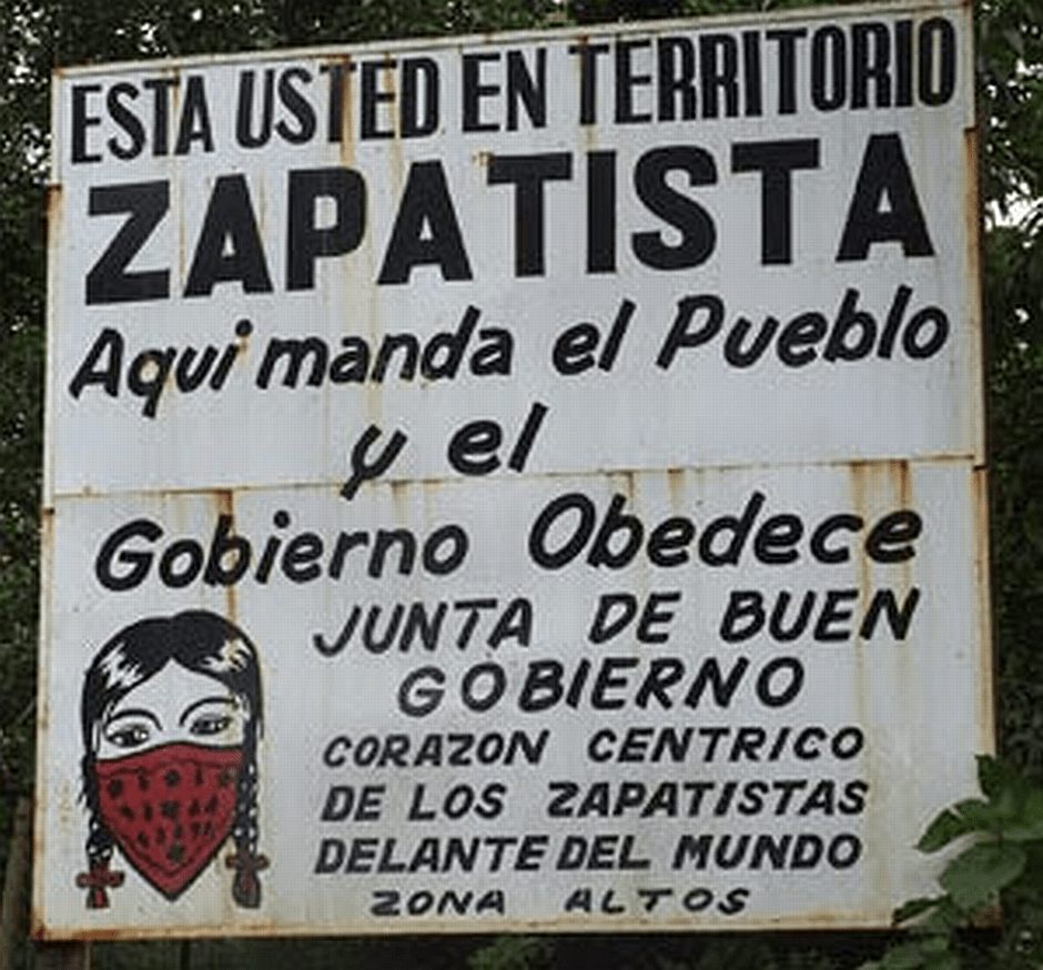 """Sign: """" You are in Zapatista Territory. Here the people lead and the good government obeys. Central Zapastista Heart of the Highlands zone"""""""