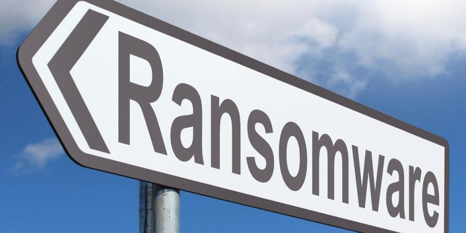 Photograph of a street direction sign with text saying Ransomware