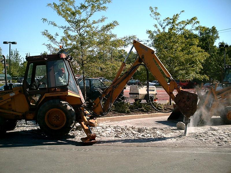 remove concrete to create a garden