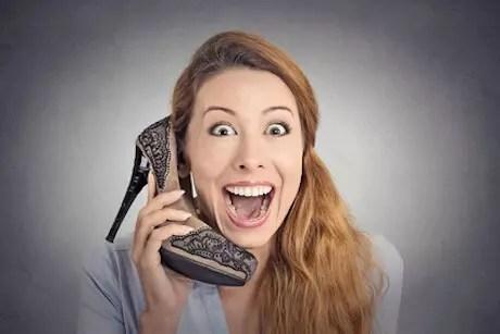Headshot happy woman excited high heeled shoe phone Nettzwerk Schweinfurt