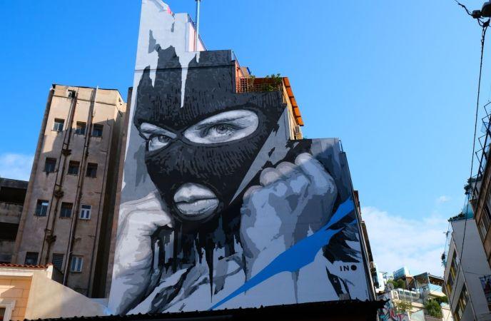 Street Art in Athen mit Maske und ohne Covid. (Foto: Walid Hamadeh, Unsplash.com)