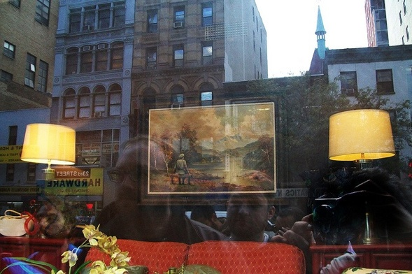 Banksy in a thrift store window, 23. Street. Photo by Allan Molho
