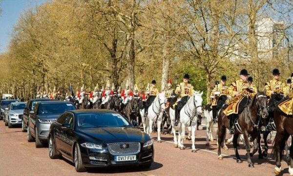 Prince Charles along with Commonwealth heads being transported from Buckingham Palace to St. James's Palcace for a meeting with the pm.
