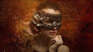 A woman wearing a masquerade mask