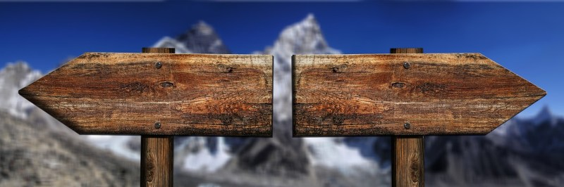 2 wooden signposts facing in opposite directions