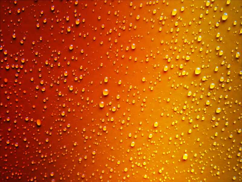water droplets on red and yellow wallpaper