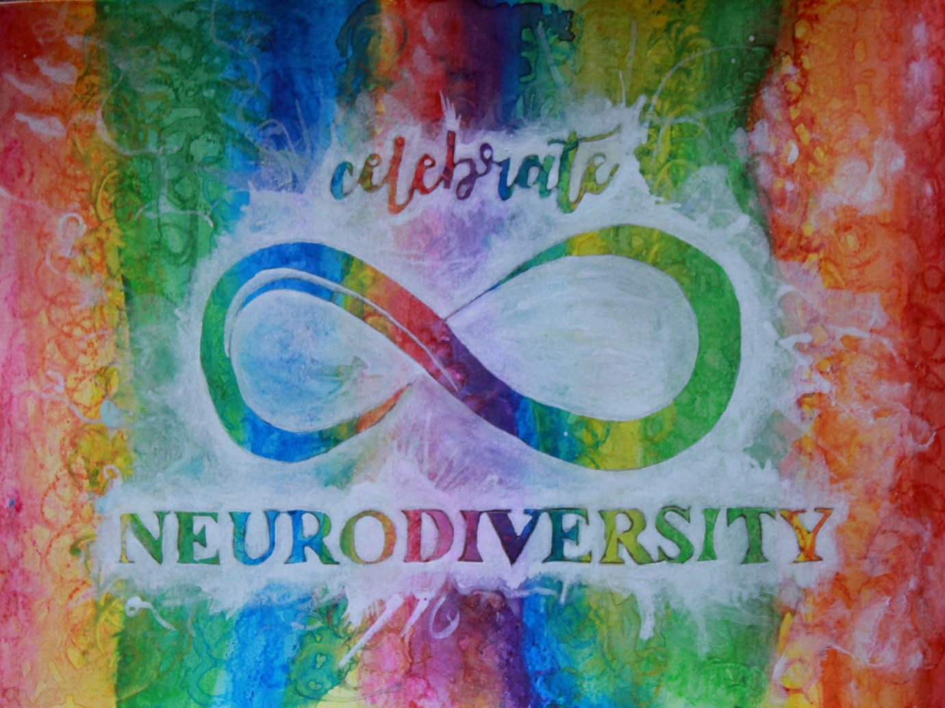 """the background has vertical watercolor stripes that blend together in a rainbow pattern. The foreground shows the neurodiversity infinity symbol, with the word """"celebrate"""" above and """"neurodiversity"""" below, from white semi-transparent acrylic paint. It looks like a white splash on a rainbow background with the words and symbols unpainted, so that the words and symbol have the same rainbow coloring as the background via negative space."""