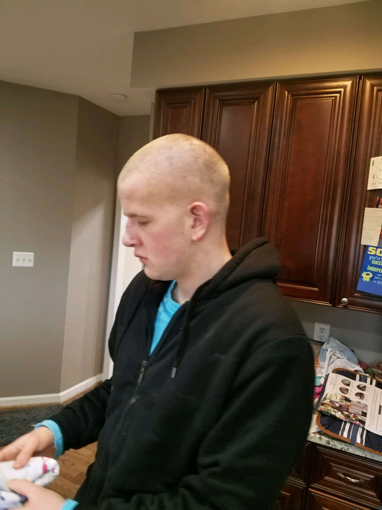 Image of Trevor with a shaved head, having made a recovery from his very. very. very. uneven recent cut.