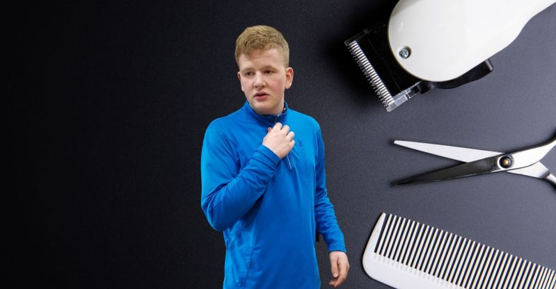 Trevor Types, a blonde teen with a sharp haircut, stands in front of a background with scissors, hair clippers, and a comb. Image resembles a magazine advertisement