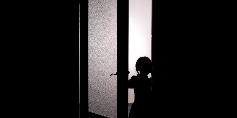 Child in dark doorway arouses fear like an ABA horror story
