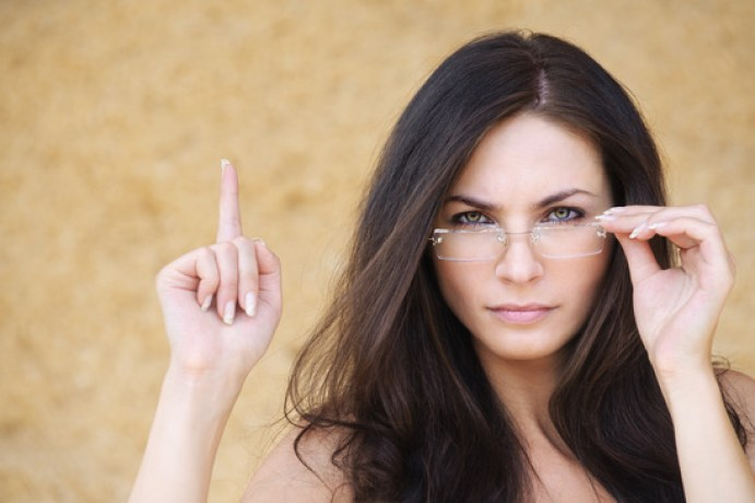 young strict woman wearing eyeglasses