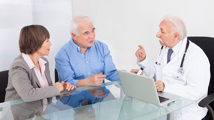 Senior Couple Discussing With Doctor