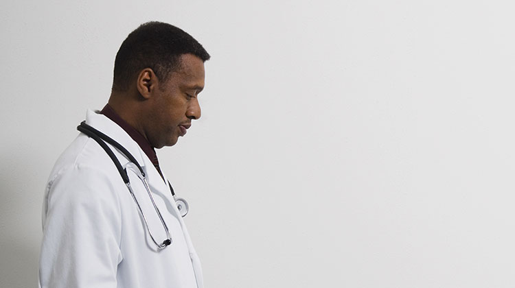 Doctor walking with head down