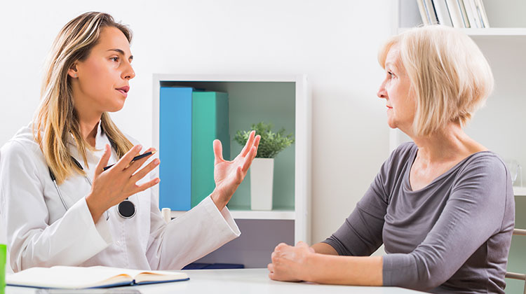 Doctor explaining treatment to patient