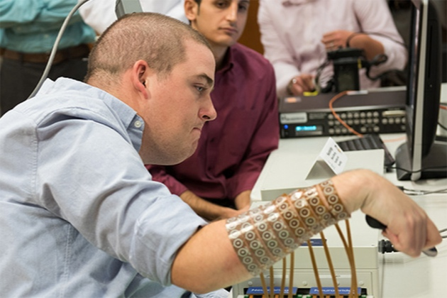 First paralysed person to be 'reanimated' offers neuroscience insights
