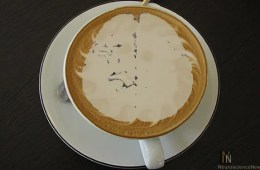 A cup of coffee is shown with the froth in the shape of a brain.
