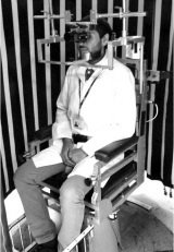 The image shows a participant sitting in the motorized chair, as described in the article.