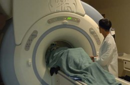 The image shows a patient undergoing MRI neuroimaging.