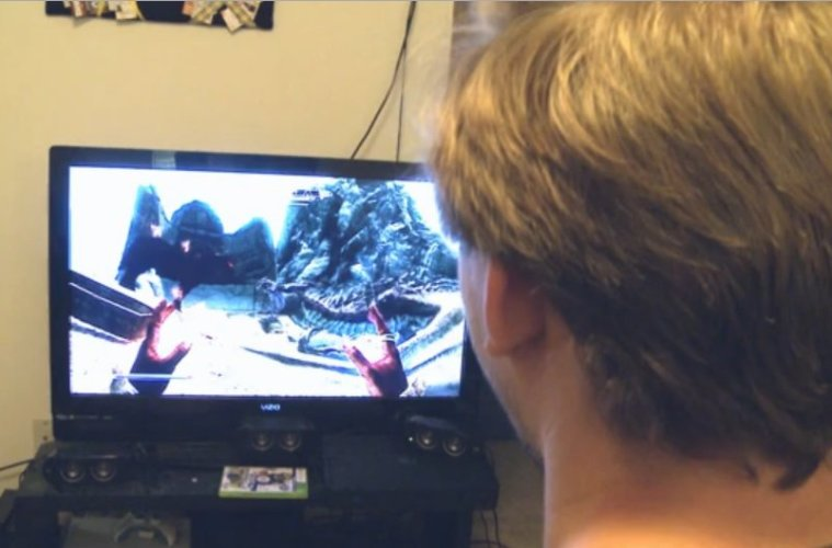 The image shows a person playing a video game.