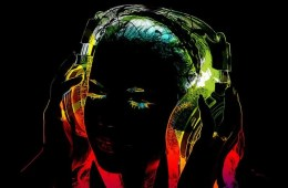 The image shows an outline of a girl listening with a pair of headphones on.