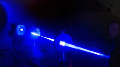 The image shows a blue laser beam.