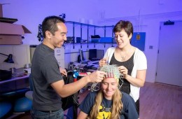 This image shows the researchers and a study participant.