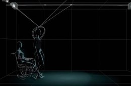 This image is a still from the video showing a 3d rendering of a person standing up from a wheelchair.