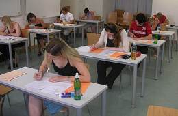 This image shows people taking an exam at school.