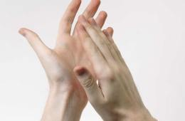 This image shows a pair of hands clapping.