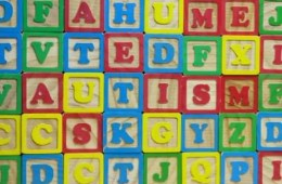 The image shows blocks with the word Autism spelled out.