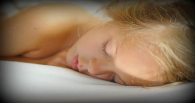 The image shows a young adult female sleeping.