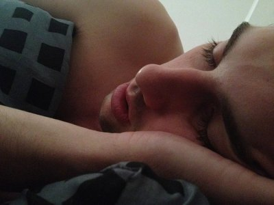 This image shows a sleeping man.
