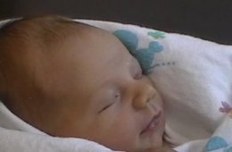 This image is a photo of a gorgeous newborn girl.